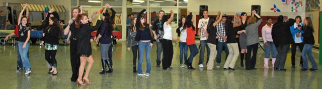 teaching students in salsa, tango, lindy, Ballroom & Latin dancing